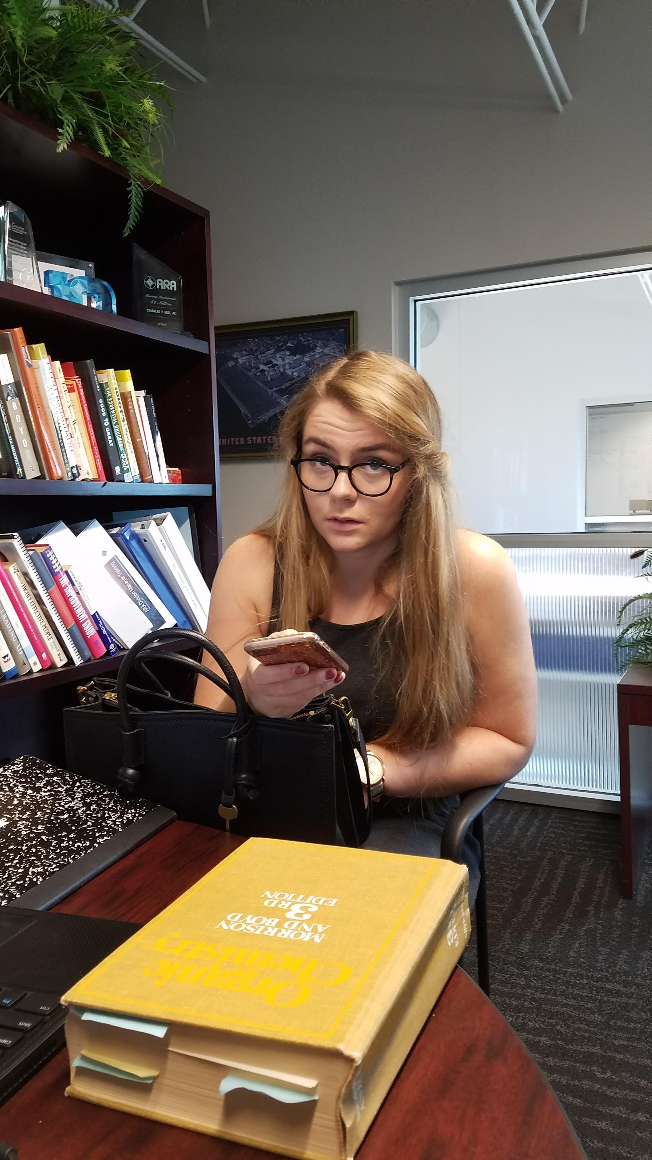 Rosie Red at a desk